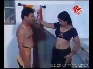 Dark-hued sari steaming aunty
