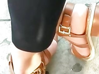 Candid soles --- Pakistani dark-haired at bus stop