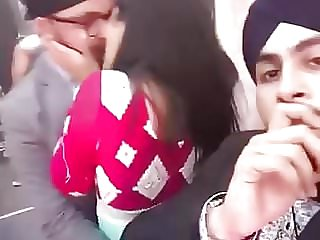 punjabi men having fun with a dame in public