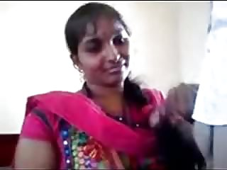 Fledgling Desi Cougar in pinkish sari posing on camera.mp4