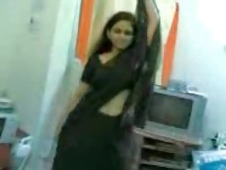 Obese indian doll undressing and dancing