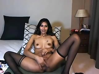 Indian hotty penetrates a faux-cock on cam