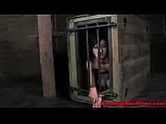 Caged sub tugging hard cock