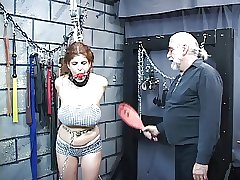 Cute youthfull sandy-haired is tied in dungeon and lashed to damaging