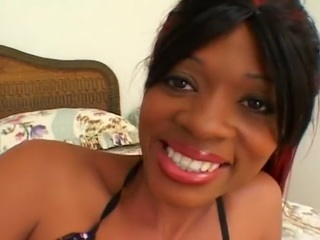 This gorgeous black amateur is looking for some extra cock, so she calls in hardcore porn stars Devlin Weed and Darren James to give her a brutal double teaming.  She gets comfortable on the bed with the two gentlemen, who pull off her bikini bottoms and pulls her bra to one side to reveal her nice breasts with pointy nipples.  After she has sucked both men to a full erection, they take turns hammering both her holes.  At first they fuck her tight pussy, but then she gets on top and rides their pricks reverse cowgirl with her anus.  She moans and squeals while they fill up her tight butt, finally both delivering two huge semen facials.