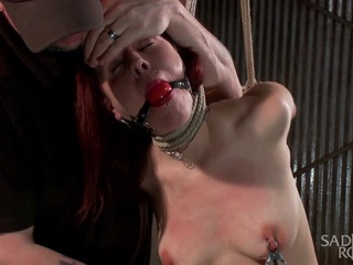 Cherry walks in and tells me that she is up for the challenge of being fisted by me. We talk a little more, and I realize that she is a massive pain slut that loves being tied up. She is put in brutal bondage and tormented, until her hungry cunt finally is ready for my huge fist.