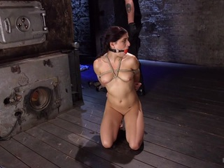 Nikki is the perfect damsel with her big brown eyes and her sexy little body, and don't forget the pigtails. She is dragged in to the scene and stripped of her clothes. The rope hits her skin and this slut falls into a submissive state. The bondage becomes more grueling and her pussy becomes wet from her suffering.