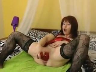 Mature woman uses big red brutal dildo