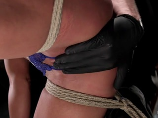 Ariel returns after almost three years and she proves that it was well worth the wait. We begin with her in a brutal stress position that puts her toned body to the test. She is tied in a squatting position with her neck tied up to keep her from cheating her way through the scene.