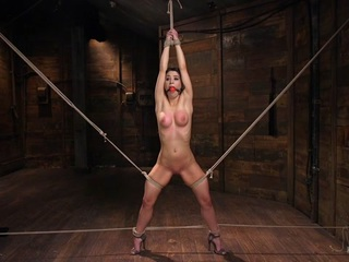 Serena and her fucking perfect little body look amazing in bondage. She is helpless from the first moment that she sets foot on set. The ropes are inescapable and punishing at the same time. She is suspended in a brutal single point suspension that very few can endure. She is tormented and taken to a point of suffering from punishment that she hasn't been to in a very long time. After all of that we make her cum, and holy fuck does she cum. Her orgasms are as intense as the bondage and punishment.