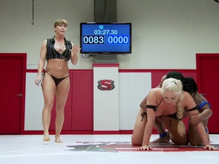 Holly Heart is back for season 13 and in the spirit of classic US season premieres, we put her against a rookie so she can squash her. The rookie is trapped on the mats and makes pathetic noises while she is finger fucked tirelessly. Holly shows no mercy and even makes the rookie quit before she can go 3 rounds. Loser is brutally humiliated and worships the winners body and feet