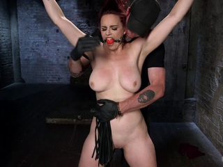 Bella is fucking back and looking hotter than ever. We begin with a standing spread eagle, her hair tied up, and the anxiety begins. She is flogged all over and then a crotch rope is added before she is allowed her final orgasms for this scene.