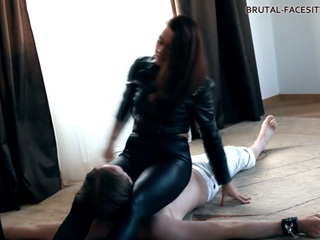 Sexual satisfaction is not Mistress Nicole's main objective in her femdom shoots – she enjoys breaking her slaves in even more than using their tongues and dicks. Here in this video you will see her proving that! She doesn't even take her skin-tight yoga pants off her nice-sized booty when she gets down to facesitting the fucker… It feels so damn good!