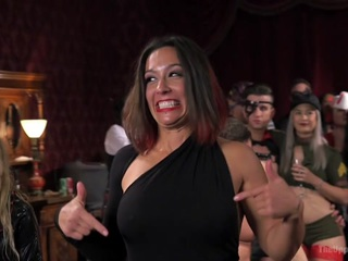 At one of our liveliest shoots of the year, 200 gorgeous and creative sadists, masochists, swingers, and lifestyle players join the Upper Floor in a wild party celebrating hot sex and real BDSM play. The orgy is served by two returning anal slaves, Penny Pax and Audrey Holiday, who bring their slutty asses and submissive knowledge to the floor in order to train the new meat girls, Goldie Rush and Aidra Fox, who are locked in a cage and swallowing cock. The senior slaves must struggle out of their bondage while being whipped, shocked, and vibrated on the sybian, then go grab a new slave and teach her the ropes. On this particular night the ropes include brutal fucking, anal service, tight bondage, zippers, floggings, and keeping Mistress Aiden Starr's pussy happy, all while collecting as many hot loads of cum as they can.