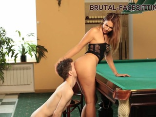 Ani Blackfox is playing with her slave at billiard club. He worries his mistress and today he will have to fully serve her pussy and ass. The mistress likes such games. She sits on slave's head like on chair. Her huge butt completely covers slave's face. He must move his tongue well to get a saving breath of air from his mistress.