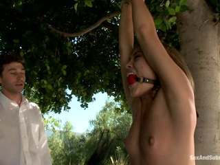 Kristina Rose is a bored house wife who has sexually fantasies of her husband doing the kind of cruel things to her that she truly desires but would not dare ask for. In one fantasy, she is tied to a tree on the side of the road by the driver. She is stripped down right in front of her husband and fucked for his amusement. Then she imagines the maid, Lizzy London, being brutally fucked along with her in bondage by both men. There are some intense scenes with hard fucking and anal sex in this erotic role play fantasy update!