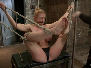 What can be said about Darling that hasn't already been said? She is tough, has an amazing figure, cums easily, loves pain, and even more importantly loves bondage. Live shows are always exceptionally tough for both the rigger and the model and this show was no exception. In scene one, Darling is perched on a fuck box with her knees pried open and her breasts bound to her feet. Freezing cold ice cubes are added to her panty to cool her town while Claire delights in tormenting Darling with the tazapper. In scene two, we subject Darling to the most brutal hogtie position one can endure. She cums easily from both the pain and pleasure that is dished out. Through the scene Claire keeps hoisting her more and more until Darling fully suspends at the end as long as she can take it. Finally Darling is bound in a standing forward bend. Mean clamps are attached to both her labia and nipples at the same time. Claire goes after her tender thighs and calves with the flip cat and fully hoists Darling into the suspension where she gets her brains expertly fucked out of her.