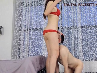 Anabella is teaching her slave to do cunnilingus. She makes the slave to get down on his knees and he pulls off her panties and starts pleasing his mistress with tongue. After a while Mistress throws the slave on the bed and sits down on his chest, pleasing herself with finger. Then she sits on his tongue with her pussy and continuing fondling herself until reaching such strongly desired orgasm. After that, Anabella present orgasm to her slave by habdjob.