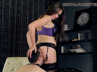 Charlotte is young beautiful mistress. She loves training slaves. This time she is engaged with her foot slave. The slave is kissing mistress's beautiful feet after pulling off stockings from her slender long legs. He is lucky today, mistress does footjob to him. After such hot entertainment mistress sits on slave's face, and finishes her work with hand.