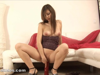 Little Lili poking a lengthy red brutal vibrator in her taut cookie