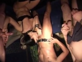 Horny and sexy brunette slave girl is in the middle of a gangbang by three men fisting and fucking her submissive pussy.