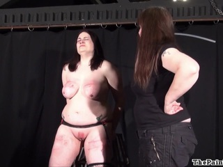 Brutal lesbo sadomasochism and bizarre flogging of big beautiful woman dilettante slavegirl Alyss in hellpain whipping and lezdom caning