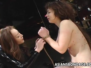 In this superb scene we find an Asian babe tied up and she is being BDSM by her Lesbian master.  Her ass is covered in the marks from the cruel action.