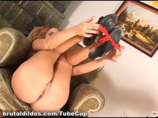Redhead beauty Charlie cums from a big brutal dildo