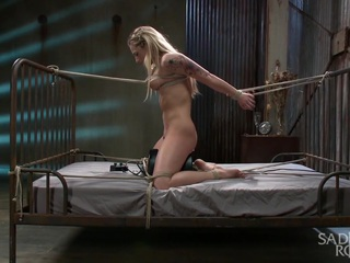 Dahlia starts out bound atop a sybian, arms in a strappado, and stretched between the bed posts. Her nipples are stretched and her body quickly turns a bright shade of red from all of the flogging. Next, Dahlia is hung upside down over the bed in a strenuous predicament. Her nipples are again assaulted, along with her cunt, before applying a crotch rope that increases her suffering. The rope is split and her pussy is filled and fucked. It's time for a suspension, but not just a suspension. Dahlia is pulled into an extreme back bend, with only her toes and fingers touching the ground. More screams from the pain fill the room, her pussy and ass get fucked, and then Dahlia is lifted into the air by her waist. We end the day with Dahlia spread out on the bed and her body abused more than she has ever encountered. The suffering added to her already intense orgasms.