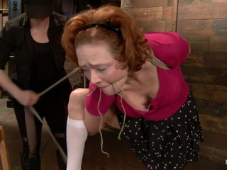 Welcome tough and beautiful Audrey Hollander to the stage. Tenacious, flirty ginger gets it hard today on HogTied. First up she is bound in the same tie three ways. First standing, the hardest. We watch the sweat pour off of her body as she tries to maintain the incredibly challenging position. After amazing endurance, our ginger bitch is let down to the floor and given a predicament. For as long as she takes the vibrator is as long as she has to endure an incredibly brutal suspension.