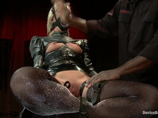 Beautiful blonde Maia gets to learn what her limits are with Jack at the helm. Each position tests her and makes her realize that Device is no joke. In scene one, she is encased in latex legs Indian style, strapped to a reclining board. Her anxiety is ramped up with the corset on. She feels like she is being smothered. Every sensation is heightened as its laced with fear. Jack soaks it up and revels in her discomfort. Scene two, she is challenged with an unforgiving forward bend in metal. Jack goes after her calves with the crop. She caves. He smiles. In the final position she gets to learn how cruel leather straps can be. She is attached to the violet wand via the grounding pad. Every time Jack touches her its electrifying. The princess melts with pleasure at his touch and earns orgasms worthy of her suffering.