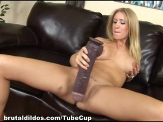 Blonde teen Allison is stretched out by a long brutal dildo
