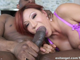 Busty Asian MILF bombshell Ava Devine is hungry for big, black cock. Who better to stretch out her asshole than muscular stud Prince Yahshua? The nasty, lingerie-clad lady thrusts four fingers deep up her massive booty and lewdly squats over a huge anal reamer to loosen her rectum before hungrily slurping Yahshua's enormous, meaty member. Ava likes getting roughly gagged and slapped, and the dominant stud happy obliges with brutal sodomy and ass-to-mouth perversion. After a hard, ruthless session of interracial ass fucking, this exotic mama enjoys a mouthful of hot cum.