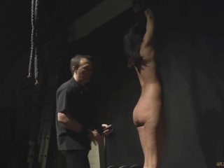 Brunette tide up, suspended and body spanked in bdsm submission
