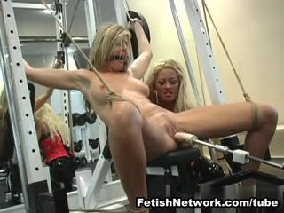 This hot blonde was working out at a private gym when her mistress decided that maybe it`s best to give her a different workout. Her blonde mistress started slow and teasingly, just stripping her down and rubbing her pussy a bit. This blonde chick tried to resist at first but when her mistress tied her hands above her head and her legs splayed wide and tide in both ends, this blonde slave sure looked like one feast waiting to be savored. Her mistress sure did enjoy her hot body, making sure to put nipple clamps on both her nips. She then starts manhandling this slave`s big tits even choking this slut a couple of times. Of course, the real punishment was when this slave was made to orgasm with a bdsm machine plugged in her pussy and then later on using a vibrator up her clit. This blonde slut was so wet from all the pussy stimulation that she was basically fighting her bonds and trying to scream through her gag. Of course, that wasn`t the end as this cruel mistress took out her favorite toy, a 15-inch cock monster.