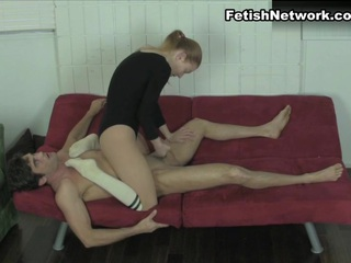 Brenna Pepper is wearing a leotard, shiny tights and white socks. She feeling pretty cruel today. She tells Lance Hart that she's going to give him a handjob but it's clear that she isn't going to be very nice about it. She knees and kicks him in the balls, flicks and slaps his dick, bringing on intense CBT play and humiliation. She finally milks him, making cum out all over her leotard while she straddles him.