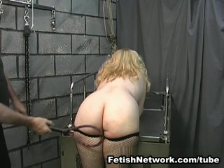 Gorgeous Linda is a horny blonde BBW lady who is in the mood to get used and humiliated like never before. She is tied up and there are metal toys around her hard nipples which are causing her severe pain but she is acting like she doesn`t feel the pain at all. That is making her master even hornier as he is getting ready for some ass whipping. There is nothing he loves more than to see a big blonde lady with a red bottom so she better push it out since he is more than ready to teach her a lesson. That is not all since squeezing hard nipples is also one of the things that he enjoys doing but she had no idea about it. This guy is not gentle at all but he loves to twist them and cause her pain like there is no tomorrow, and that is what you can see in here. You are probably going to feel sorry for her but there is no need for that since pain is causing her to feel extremely pleased and that is why she always gets off hard.