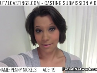 They pile into our casting office every single day and then tell our agent they have no interest in nude modeling, or aren't comfortable taking their clothes off on camera. When will these little cum slobs learn that they have to go outside of their comfort zones and do whatever it takes to become famous? When? Well, Penny Nickles is going to learn that today, right fucking now! This petite 19-year-old looks like a deer in the headlights when it's time to show our agent the goods, and tries to stall the inevitable even further by offering to send her portfolio by the office later. The nerve. This loopy wannabe college model may have come to us in the hopes of a life of luxury, fame and riches, but she's going to leave here a submissive, whimpering sex slave with a load of our agent's salty hot cum clinging to her chin like Santa's beard. Penny says she's a part time dog trainer, but the agent quickly turns the tables on her and shows her who the bitch in training really is with a brutal deepthroat fucking that leaves her gasping and dazed. Then he puts a gag ball in her slut mouth and pounds out her pussy like a chicken cutlet until he's about to cum. He pulls out and blasts his load all over her face and gag ball, removes it, and makes her eat all of the cum off of it. Do you feel famous yet, Penny?