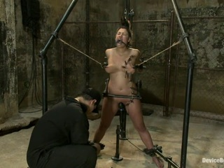 This is Dana Vixen's last scene from our recent shoot with her. We've learned from her previous scenes that this girl can take some serious play  so this is where we go all out and indulge ourselves. Standing inside a metal frame  we bind Dana's lovely curvy body with her arms back in strappado. We shove a dick up her tight wet cunt  keep a vibrator on her clit and plug her ass. We tie her hair to the top of the frame so we can see every emotion flash across that pretty face. We funnel gag her because we like our tits big  natural  and covered in drool. We clamp her nipples and tie them to the frame. Our sneaky little whore has a hard time controlling herself and has an orgasm without asking permission. We flog her  zipper her  make her spit on her tits  and watch as she has some screaming  shaking  beastly brutal orgasms.