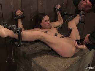 It's been about two years since we have seen Amber Rayne on Device Bondage so we thought it was time to bring back this flexible anal queen. Severely bound  spread out  and helpless  Amber's holes are wide open for anything we want to do them. After some hard caning of the feet and some brutal flogging  we torture Amber's poor nipples with weights and clamps. After teasing Amber with the vibrator and refusing her orgasms  we find one of the biggest toys we have and impale her ass with it. After a rough ass fucking we lock the massive dildo in place  and then fuck her pussy with another toy  then we vibrate her swollen clit to orgasm after helpless orgasm.