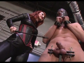 Leather-clad Mistress tortures slaves cock and balls before allowing him to cum on her boots and lick up his mess.