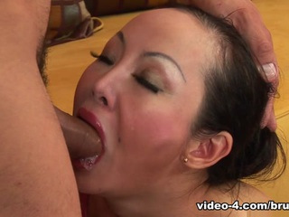 Angie Venus is a hot mature Asian with a great pair of tits and an ass made to fuck. As her man gets near, she opens her mouth and she deep throats his huge cock until she drools. He grabs her head and slams his cock in her open mouth and loves it. She has a sexy Asian body and her shaved pussy is fucked first to get her wet. Then he moves to her ass and fucks that even deeper. She takes him anally doggiestyle, while riding him, and on her back. Her legs spread wide open, her ass is gaped and she loves it. She takes a face full of cum after the brutal anal fucking by his huge cock