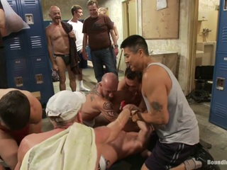 Handyman Ethan Ayers is working in the locker room and the horny guys are looking at him. They pull him away from his power tools and take him down. A couple of dudes rip off his clothes and discover that he got a huge dick. Ethan tries to fight back but he's no match for a locker room full of dudes. They fuck him with his own power tool and shove an electric butt plug up his ass. Ethan endures brutal gang bang and made to lick cum off the nasty floor.